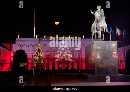 Decorative Christmas illuminations in white and red colors, lights on Presidential Palace in Warsaw and equestrian statue of Prince Jozef Poniatowski  - Stock Photo
