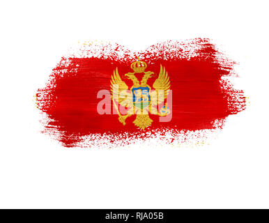 brush painted flag of Montenegro isolated on white background. - Stock Photo