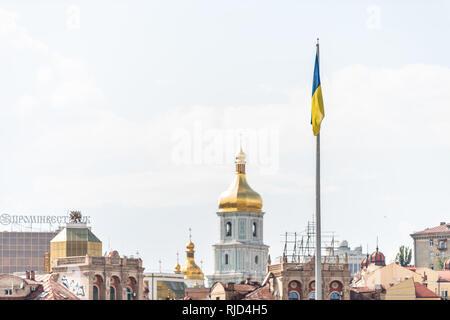 Kyiv, Ukraine - August 12, 2018: Cityscape skyline of Kiev on Independence Square Maidan Nezalezhnosti city church domes cupola and flag - Stock Photo