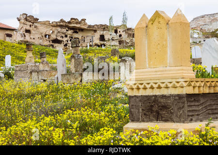 Cavusin, Nevsehir Province, Cappadocia region, Turkey : Ruins of the Church of St John the Baptist, one of the oldest in Cappadocia. In foreground, a  - Stock Photo