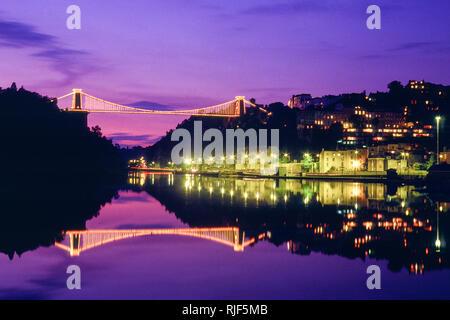 Bristol, UK; View of the Clifton suspension bridge at dusk - Stock Photo