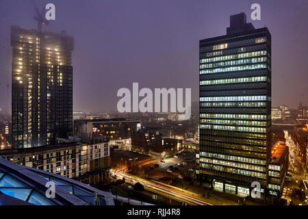 View from One Angel Square at the Grade II listed CIS Tower and the NOMA area if Manchester City Centre skyline - Stock Photo