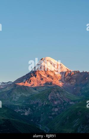 Mount Kazbek, one of the highest mountains in the Caucasus (5047m), near Stepantsminda, Georgia. - Stock Photo