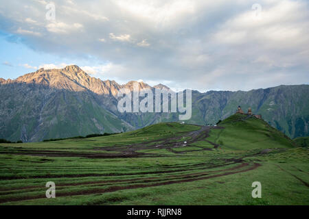 Famous Gergeti Trinity Church near Stepantsminda, Georgia, Caucasus. - Stock Photo