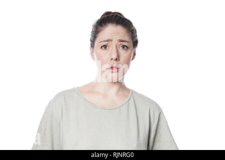 dumbfounded affronted young woman frowning with disbelief - isolated on white background - Stock Photo