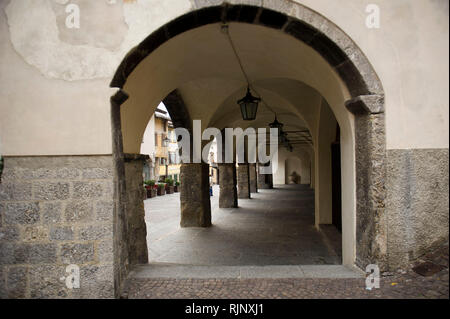 Italy, Lombardy, Clusone, porch in front of the Town Hall (1400) with the planetary clock tower of Peter Fanzago 1583 - Stock Photo