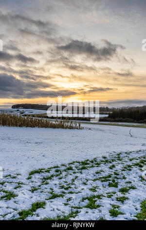 View towards Cheesefoot Head on the South Downs Way during sunset in winter 2019, South Downs National Park, England, UK - Stock Photo