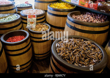 Large selection of wrapped candies in wooden barrels at Mom and Popcorn sweet shop, Main Street Downtown McKinney, Texas.  March 2018 - Stock Photo