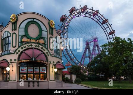 Wiener Riesenrad Ferris wheel in the Prater park, Vienna, Austria, at cloudy dusk - Stock Photo