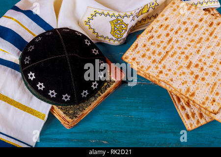 Close up of concept jewish holiday passover matzot and tallit the substitute for bread on the Jewish Passover holiday. - Stock Photo