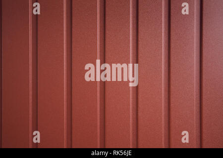 Seamless container pattern. Aluminum fence. Galvanized steel wall plate. Corrugated metal profiled panel. Metal rivets. Background of red metal siding - Stock Photo