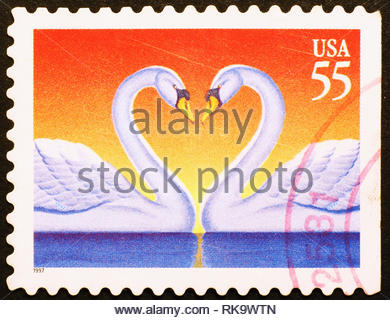 Image of two swans forming a heart shape with their necks, american postage stamp - Stock Photo