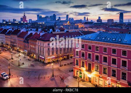 Poland, Warsaw, capital city downtown skyline at twilight evening, buildings on Krakowskie Przedmiescie street - Stock Photo