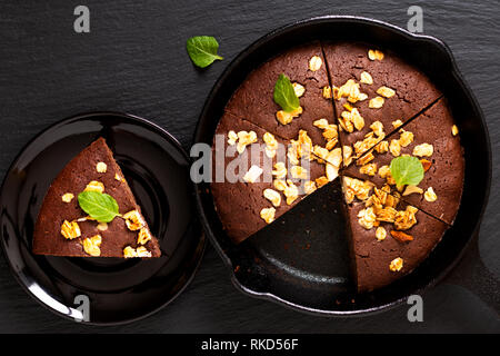 Food concept Homemade Brownies baked in iron cast skillet with copy space - Stock Photo