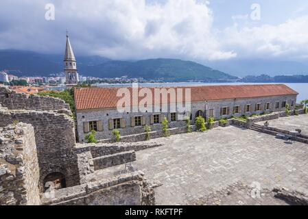 On the roof of Citadel, Old Town of Budva city on Adriatic Sea coast in Montenegro. View with bell tower of Saint John the Baptist cathedral. - Stock Photo