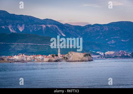 View on Old Town walls with bell tower of Saint John the Baptist cathedral in Budva city on the Adriatic Sea coast in Montenegro. - Stock Photo