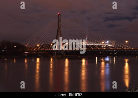 Świętokrzyski Bridge over the Vistula river in Warsaw, Poland - Stock Photo