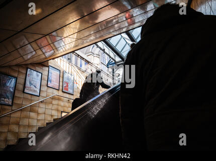 HAMBURG, GERMANY - MAR 20, 2018: Rear view of pedestrians exiting Hamburg metro station - Stock Photo