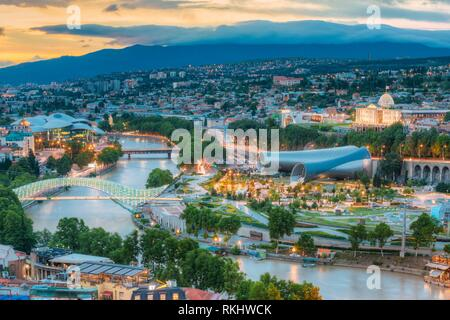 The Scenic Top View Of The Central District Of Summer Tbilisi, Georgia With All Famous Landmarks, Sightseeings In Evening Illumination, Kura Mtkvari - Stock Photo
