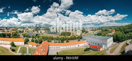 Vilnius, Lithuania. Modern City And Part Of Old Town Under Dramatic Sky In Summer Day. New Arsenal, Foundation Of Church Of St. Ann And St. Barbara, - Stock Photo