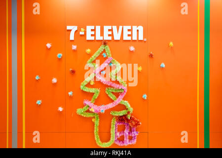 HONG KONG - CIRCA DECEMBER, 2015: 7-Eleven sign on a wall. 7-Eleven (7-11) is an international chain of convenience stores, headquartered in the Ameri - Stock Photo