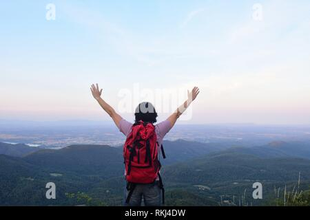 a female hiker who has reached the top. - Stock Photo