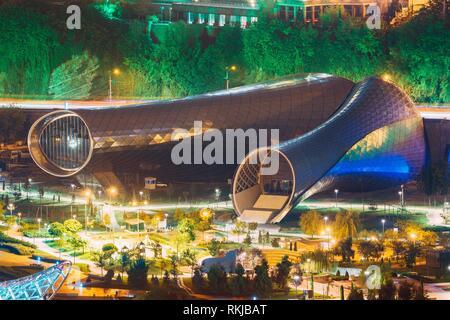 Tbilisi, Georgia - October 21, 2016: Evening Night Scenic Aerial View Of Concert Music Theatre Exhibition Hall In Summer Rike Park Tbilisi, Georgia. - Stock Photo