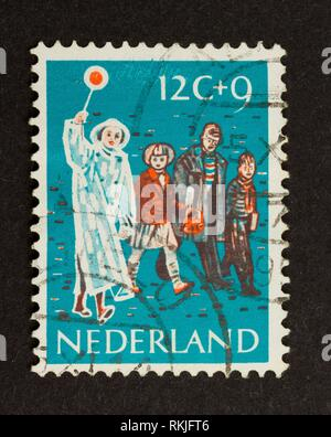 HOLLAND - CIRCA 1950: Stamp printed in the Netherlands shows children and a woman in traffic , circa 1950. - Stock Photo