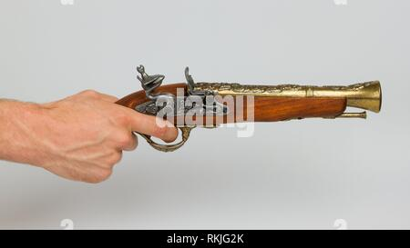 Old wooden gun isolated on white background. - Stock Photo