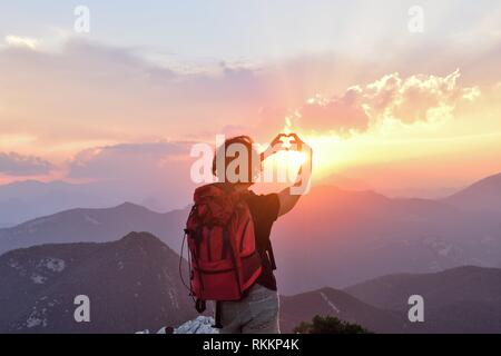 hiker woman with heard sign. - Stock Photo