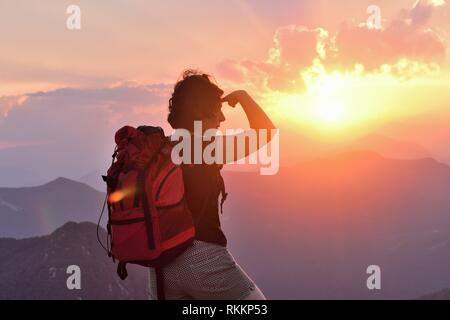 Hiker woman looking with her hand on her forehead. - Stock Photo