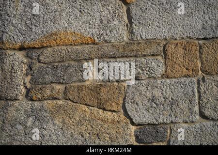 Granite stone bush hammered masonry wall in Galicia Spain. - Stock Photo
