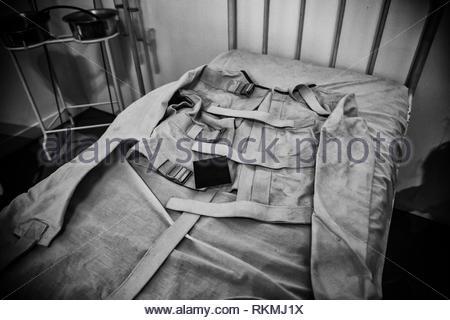Old psychiatric straitjacket, mental hospital detail, psychosis. - Stock Photo