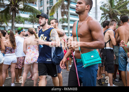 RIO DE JANEIRO - JANUARY 20, 2015: An afternoon banda street party in Ipanema draws crowds of young Brazilians during the city's Carnival celebrations - Stock Photo