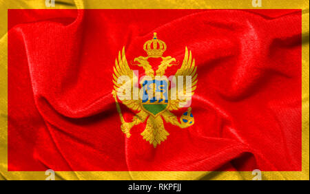 Realistic flag of Montenegro on the wavy surface of fabric - Stock Photo