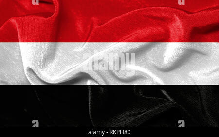 Realistic flag of Yemen on the wavy surface of fabric - Stock Photo