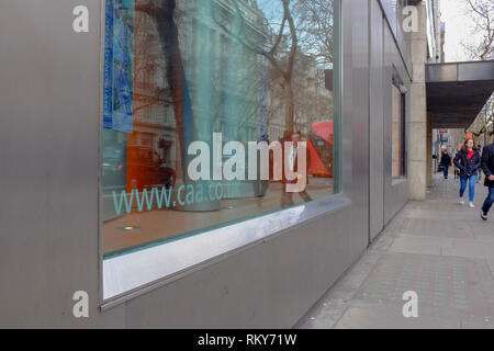 London, UK. 23 Feb, 2019. People walk past the offices of the  Civil Aviation Authority (CAA), which regulates civil aviation in the UK, in February 2 - Stock Photo