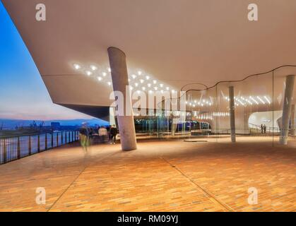 Exterior viewing terrace of the Elbphilharmonie Hamburg overlooking Hamburg Docks at twilight, designed by Herzog & de Meuron Architects, - Stock Photo