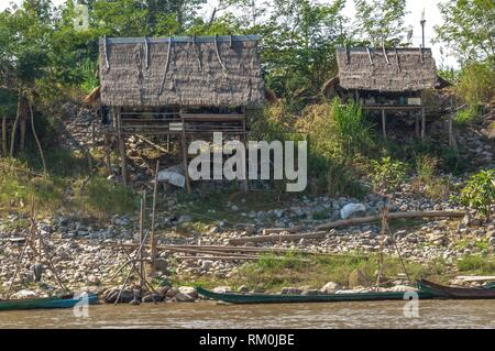 Fisherman huts by the Mekong River, Golden Triangle between Thailand, Myanmar and Laos, Sop Ruak, Northern Thailand, Thailand, Asia. - Stock Photo