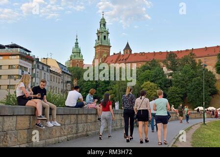 sidewalk along the Vistula river at the foot of the Wawel Castle, Malopolska Province (Lesser Poland), Poland, Central Europe. - Stock Photo
