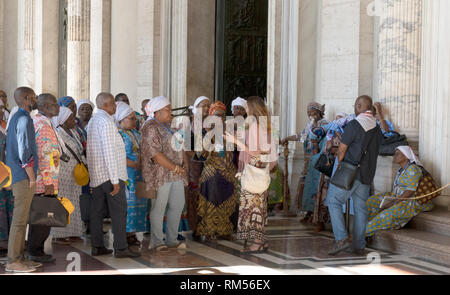 Tourists from Africa at the St. Peter's Basilica, San Pietro in Vaticano, Papal Basilica of St. Peter in the Vatican, Rome, Italy - Stock Photo
