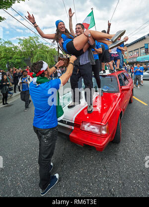 Vancouver, B.C., Canada - June 28, 2012: Italian football fans clebrating the victory at the semi finals at the 2012 UEFA European Championship - Stock Photo