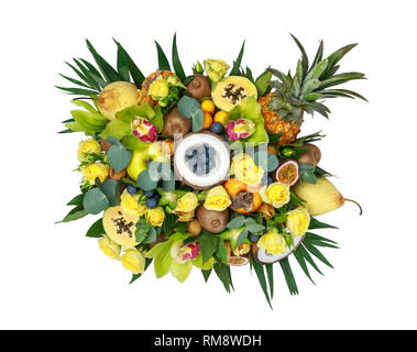 Wooden box with lots of exotic fruits and flowers isolated on white background. Top view - Stock Photo