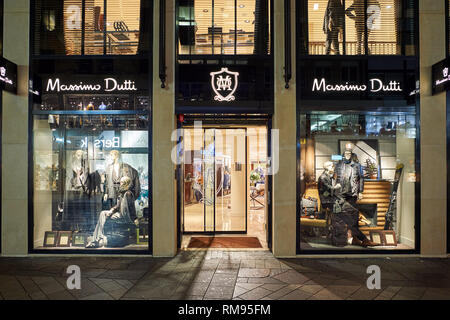 GENEVA, SWITZERLAND - NOVEMBER 18, 2015: a store in Geneva at night. Geneva is the second most populous city in Switzerland, after Zurich. - Stock Photo
