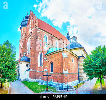 The medieval Corpus Christi Basilica is one of the oldest and most honored in the city, located in historical Kazimierz neighborhood on Krakow, Poland - Stock Photo