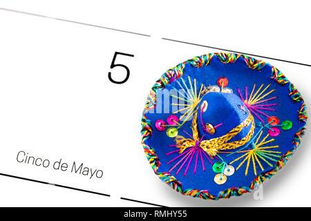Save the date white calendar for Cinco de Mayo, May 5th with blue sombrero/ Cinco de Mayo concept - Stock Photo