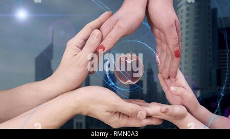Men's, women's and children's hands show a hologram 3d apple - Stock Photo