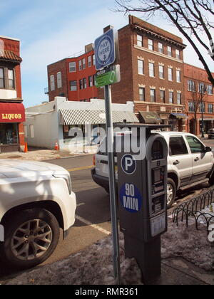 Centralized parking pay station on Summit, NJ street. Convenience for local shoppers. New high tech trends - Stock Photo