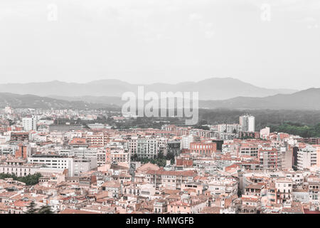 Rooftops and mountains. View over the city of Girona. Catalonia, Spain. - Stock Photo