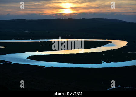 Meandering Cuckmere River at sunset, Cuckmere Haven, East Sussex, UK - Stock Photo